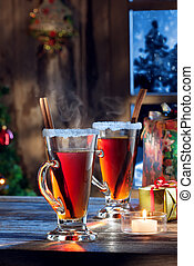x-mas wine - close up view of glass with mulled wine with...