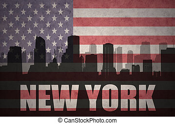 abstract silhouette of the city with text New York at the vintage american flag
