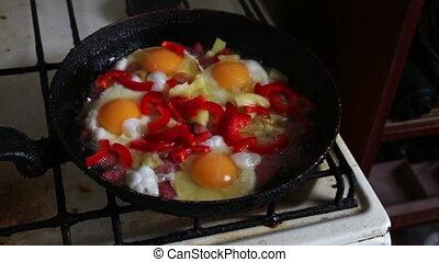 Woman salts fried eggs