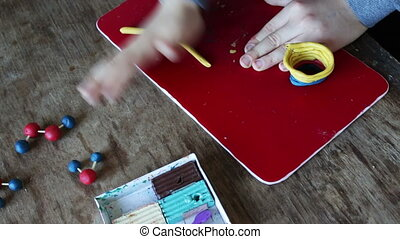 sculpts from plasticine - Child sculpts crafts from colorful...