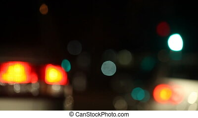 night traffic pulling away - defocused taillights of cars...