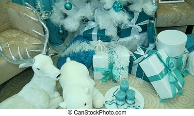 White bears. Presents under decorated Christmas tree. -...
