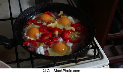 Woman pours a seasoning for eggs - Woman pours a seasoning...