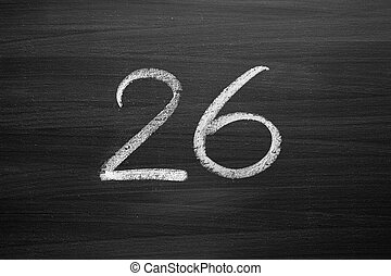 number twenty six enumeration written with a chalk on the...