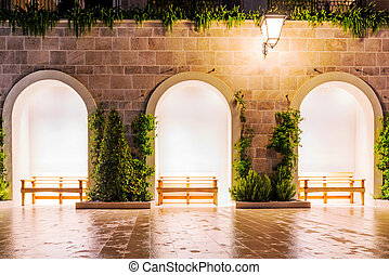 Benches at night in Tivat - Benches and architecture on...