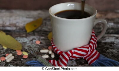 White cup of black coffee in scarf - White cup of hot black...