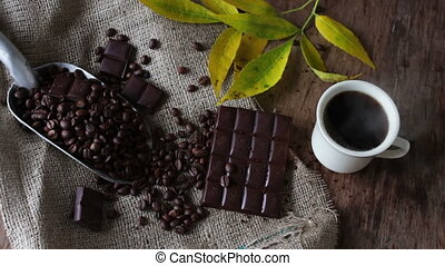 Coffee Grains chocolate and cup of coffee - White cup of...