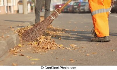Cleaning autumn leaves on the street - street cleaner...