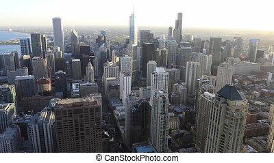 Aerial of the Chicago, Illinois city center at sunset - An...