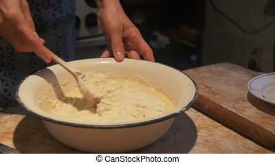 Woman is making dough