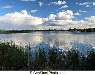 Distant Rain and Clouds Reflected in Minnesota Lake - View...