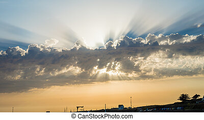 The rays of the Sun from behind the clouds