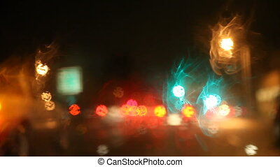 changing lanes on a rainy night - a car pulls into another...