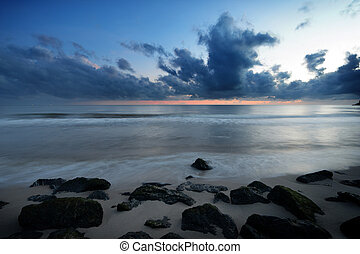 rock beach and sea in the morning before sunrise
