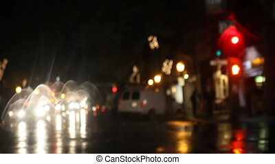 pedestrians and cars in the rain at