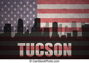 abstract silhouette of the city with text Tucson at the...