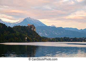 Bled with lake, castle and mountains in background,...