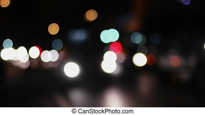 Night city street bokeh. Defocused lights blurred traffic on road. Nightlife abstract blurred shot. Night urban scene out of focus
