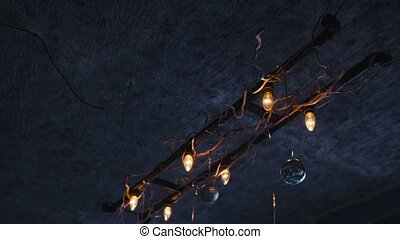 The lamp on the ceiling shine a warm light. Blue background,...