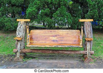 wooden bench in garden. Bench in public garden