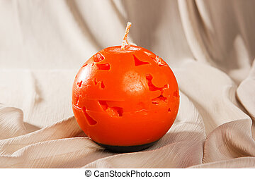 Souvenir gift candle in the shape of Carved pumpkin - orange...