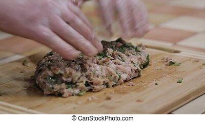 Preparing homemade meatballs for family dinner.