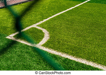 corner of a soccer field behind the fence