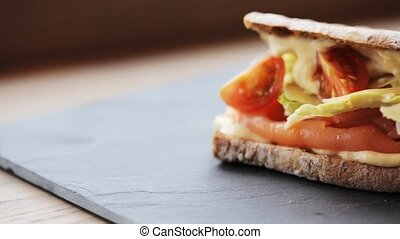 salmon panini sandwich on stone plate - food, dinner and...