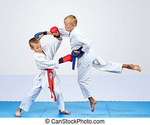 In karategi two karateka are training punch arm and block