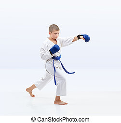 In the rack of karate athlete trains punch arm