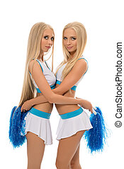 Alluring blondes posing in cheerleading uniforms. Isolated...