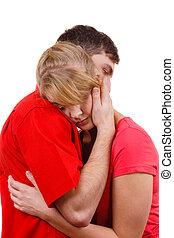 Couple. Woman is sad and being consoled by his partner -...