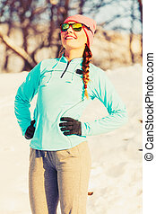 Warm up in winter. Girl exercising in frozen park. Health...