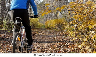 Sportsman riding in the park. - Man riding in the park on a...