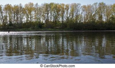 Fisherman on the river - The fisherman on the river catches...