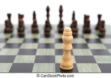 chess board with the white King faces to the black ones