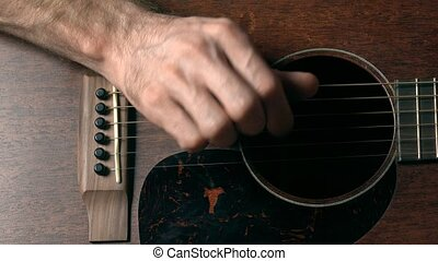 Guitar player's hand touching strings. Music performance. 4K...