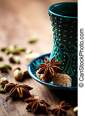 Hot drink with spices in authentic cup - Authentic blue...