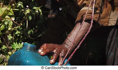 Acquiring water from a stream - People getting fresh water...