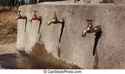 Faucet in ethiopia with dripping water - Water point with...