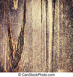 Wooden textured background with colden glitter. Christmas...