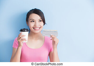 woman hold coffee with dental table isolated on blue...