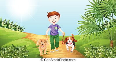 Boy taking dogs for walk in the park