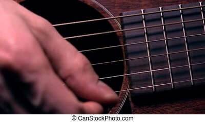 Guitarist hand touching guitar strings. Music performance....