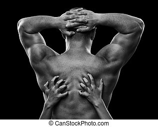 Monochrome image of a man\'s back and woman\'s hands - Woman...