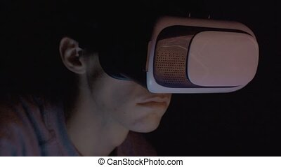 Closeup of man using virtual reality headset VR mask 4K