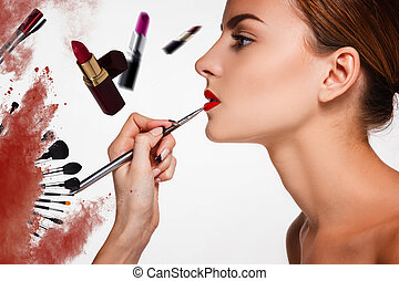 Beautiful female lips with make-up and brush on white....