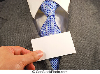 A business man showing a blank card