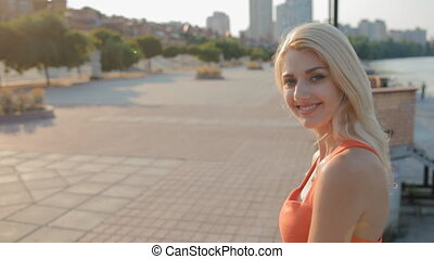 Woman take a rest on embankment - Caucasian woman with long...