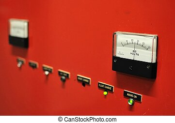 Electricity meter - Red electricity meter showing voltage...